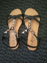 pair of black-and-brown leather sandals Houston, 77017