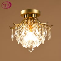 gold-colored and white uplight chandelier null