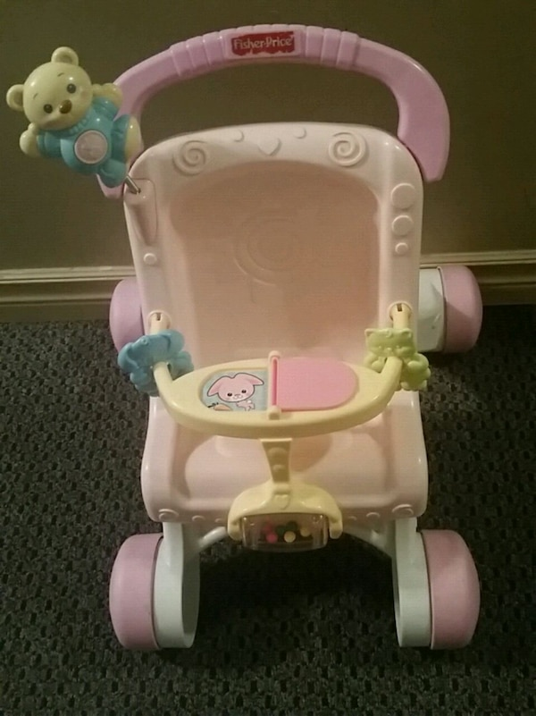 baby's white and pink highchair