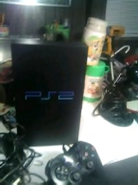 black Sony PS3 game console with controller Conestoga, 17516