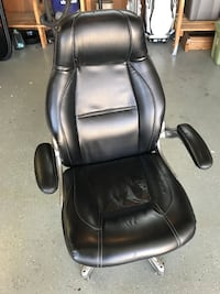 black leather office rolling armchair