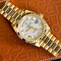 round gold-colored analog watch with link bracelet California