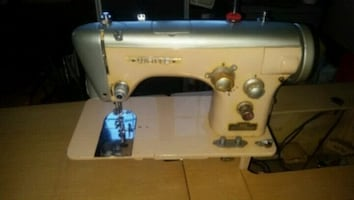 Vintage WHITE sewing machine and cabinet