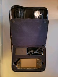 Used PSP w/ carry case and multiple disks
