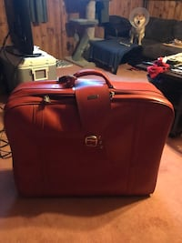 red leather case bag