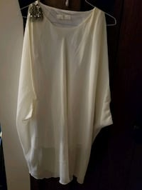 Ladies oversized sleeveless blouse.  Edmonton, T5C 1Z4