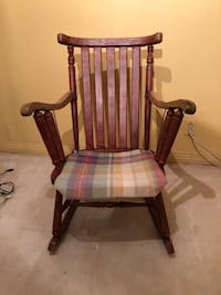 Brown wooden antique rustic rocking chair