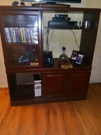 brown wooden TV stand with flat screen television Beaumont, 77701