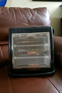 Space heater with safety switch on the bottom