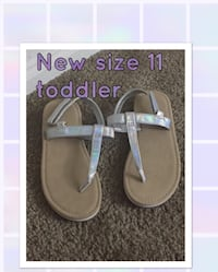 pair of girl's brown-and-white leather sandals