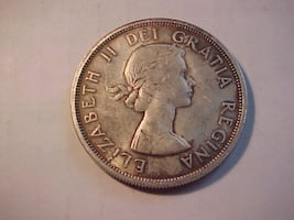 Full Luster Satin 1963 Silver Dollar Young Queen