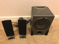 two black multimedia speakers with remote 1458 mi