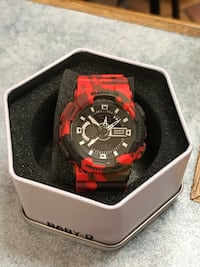 round black and red digital watch