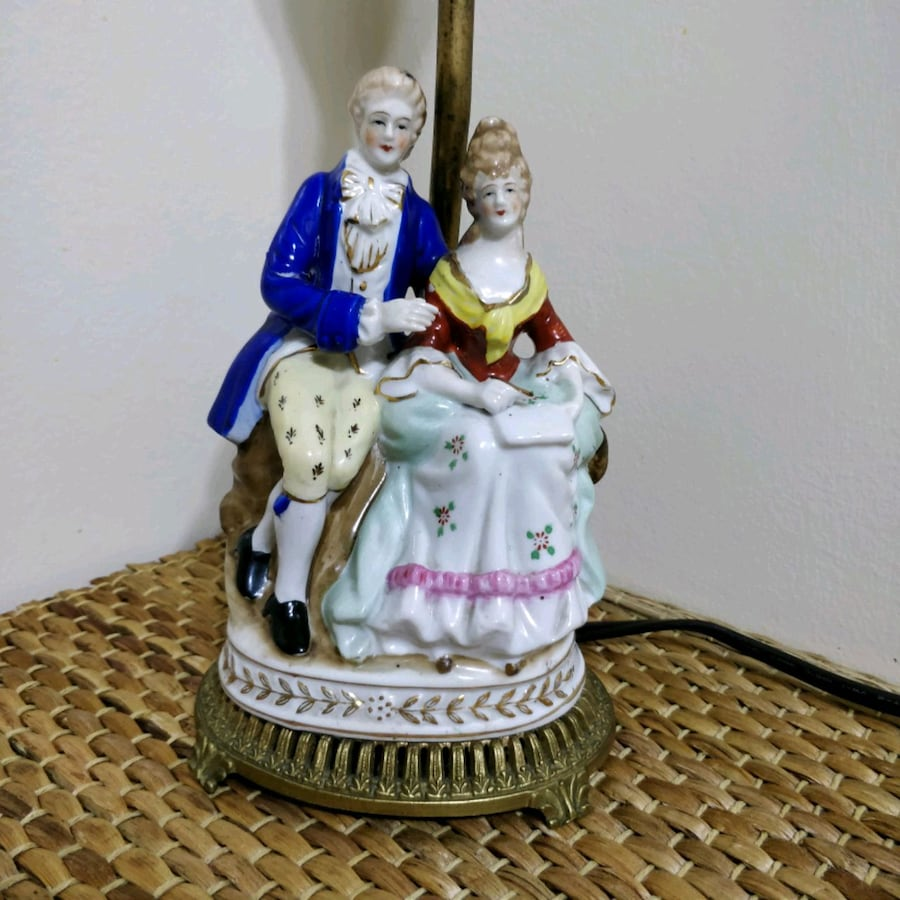 Antique figural lamp in working condition