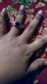 silver-colored ring with blue gemstone 36 km