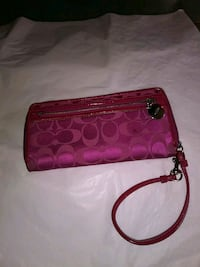 red and black Coach wristlet 2357 mi