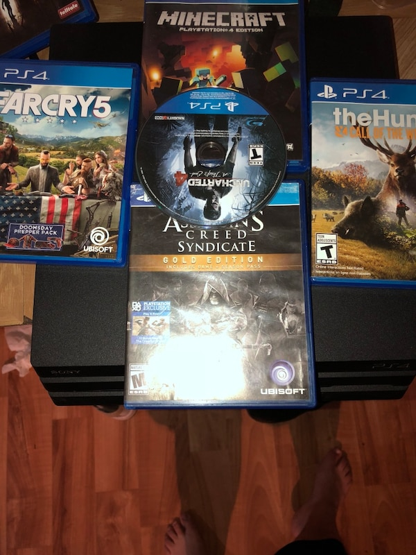 Ps4 pro with games shown on the picture and one control/all cables.willing to trade for Xbox one x only!