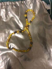 gold-colored necklace with pendant 1273 mi