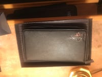 100% real Prada wallet with mini pencil inside , comes with box and authenticity card real leather condition new Newark, 07106