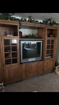 brown wooden TV hutch with gray CRT television Kaysville, 84037