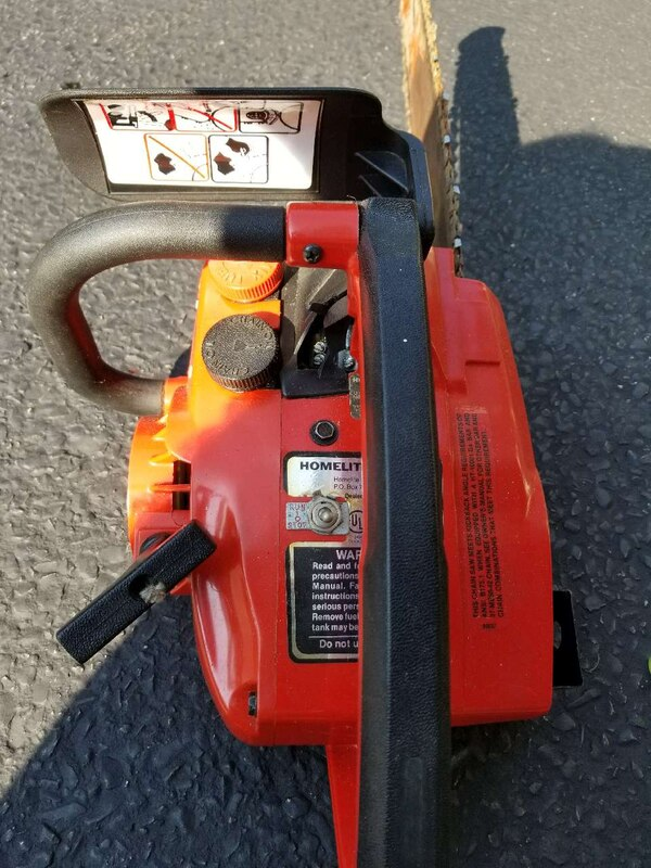 red and black Homelite chainsaw