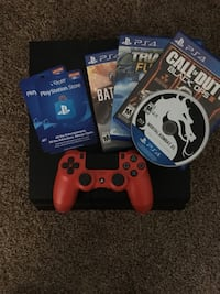 Red sony ps4 console with controller and game cases Wellsville, 84339
