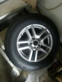 chrome 5-spoke auto wheel with tire