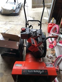 Red and black ariens st5 snow blower