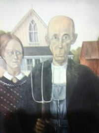 man and woman near house painting