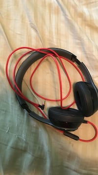 Black and red Beats Corded headphones