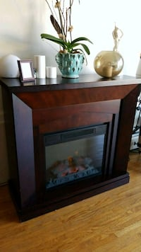 Brown and black wooden electric fireplace Vancouver, V6K 1E9