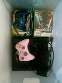 black Xbox 360 console with controllers and game c 44 km