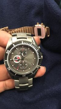 Round black Michael Kors chronograph watch with silver-colored link bracelet