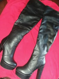 pair of black leather knee high boots Houston, 77039