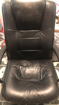 Black leather padded rolling armchair Dade City, 33523