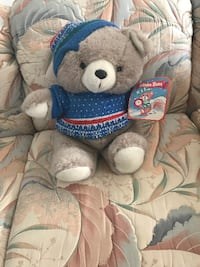 blue and white bear plush toy null