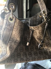 Brown and tan with faux snake skin strap monogrammed Michael Kors  Victorville