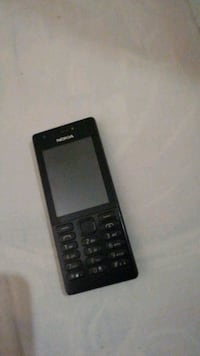 black and gray Nokia candy bar phone