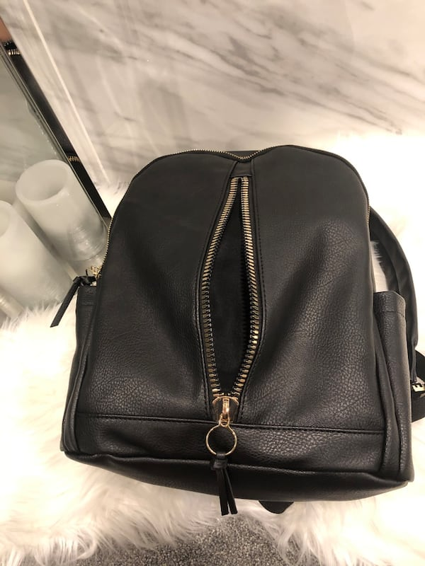 Madden girl black and gold leather backpack **OPEN TO OFFERS**. 0da165a0-0872-43f3-b07c-ec19eb851b94