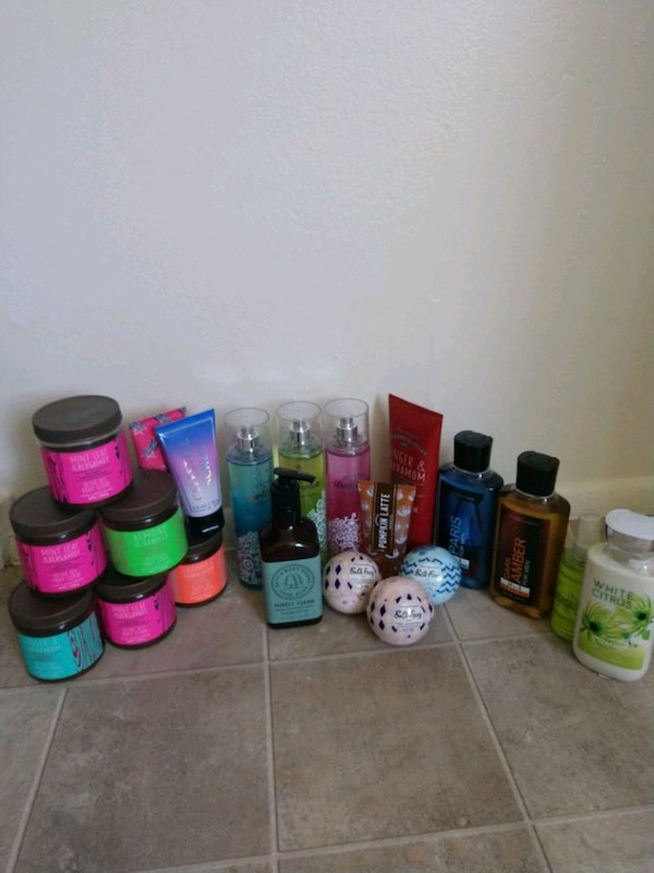 assorted body fragrances, lotions, and more