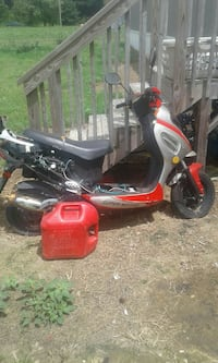 red and gray automatatic scooter