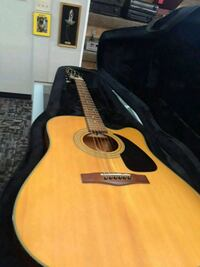 brown and black acoustic guitar with case Flint, 48503