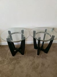 round glass top table with black wooden base Oxon Hill