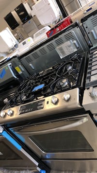 GE slide gas stove like new with 4 months warranty  Bowie, 20715