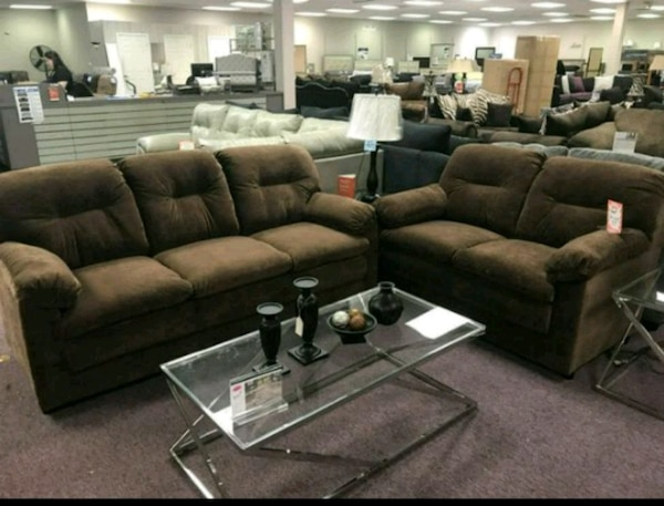Used brown leather sectional sofa with ottoman for sale in Garland ...