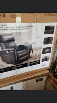 Leather recliner brand new in box