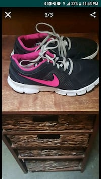 pair of black-and-pink Nike running shoes El Paso, 79936