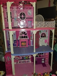Pink, white, and blue plastic 3-storey dollhouse toy