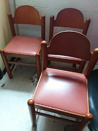 brown wooden framed red leather padded armchair
