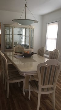 rectangular white wooden table with six chairs dining set